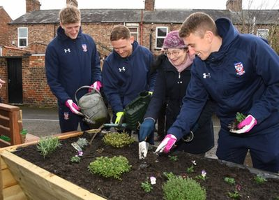 (L-R) Alex Kempster, Kallum Griffiths, Kay Watkins (The Lanes Community Garden) and David Ferguson lending a helping hand..jpg