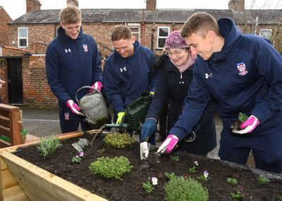 (L-R) Alex Kempster, Kallum Griffiths, Kay Watkins (The Lanes Community Garden) and David Ferguson lending a helping hand..jpg