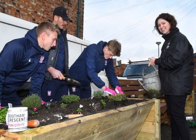 (L-R) York City players David Ferguson, Pete Jameson and Alex Kempster helping Michelle McCarthy from TalkTalk UFO with planting flowerbeds.jpg